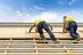 Concept Of Building New Wood Or Wooden House. Two Mature And Professional Worker Standing On Roof To poster