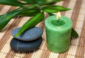 Bamboo, zen stones and candle in spa still life