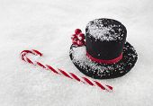 black top hat snowman with cane on white snow ,  christmas  background