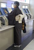 Japanese Woman in Subway Station