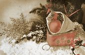 retro image of sleigh with christmas ornaments in the bag