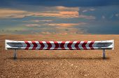 hard steel guardrail on soil land with dramatic colorful sky