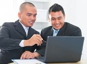 Southeast Asian businessteam discuss in office