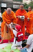 Mass Alms Giving In Bangkok, Thailand
