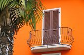 Balcony Of A House With An Orange Facade