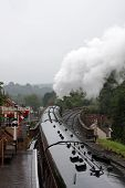 A Steam Train Leaving The Station