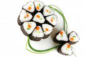rolls served over white with green stems