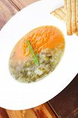 european cuisine: dual components vegetable soup with toasts over wood