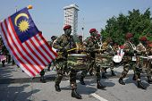 KUALA LUMPUR - AUGUST 31: Drummers and musicians from the 10th Airborne Brigade march on the city st
