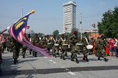 KUALA LUMPUR - AUGUST 31: Drummers and musicians from the 10th Airborne Brigade march on the city streets as celebrating Malaysia's Independence Day on August 31, 2013 in Kuala Lumpur, Malaysia.