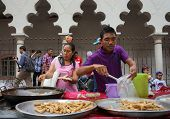 KUALA LUMPUR - AUGUST 31: Street vendors sell local delicacies and fast food to revelers on the stre