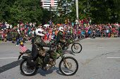 KUALA LUMPUR - AUGUST 31: Scrambler bikes from the infantry scout platoon take to the city streets in a parade as Malaysians celebrate Independence Day on August 31, 2013 in Kuala Lumpur, Malaysia.