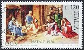ITALY - CIRCA 1978: a stamp printed in Italy celebrates Christmas showing a nativity scene. Italy, c