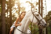 foto of horse girl  - Beautiful woman on a horse - JPG