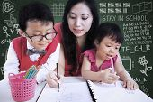 Beautiful Teacher Help Children Write Letters In Class