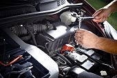 Auto mechanic working in garage. Repair service.