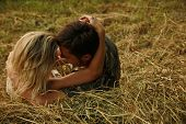 Couple In Love On A Haystack In Nature