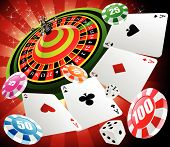 stock photo of roulette table  - a roulette table with various gambling elements - JPG
