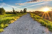 Gravel Path With Setting Sun Star
