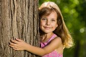 Little Girl Near A Tree