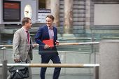 image of father time  - Two generation of businessmen talking during business travel - JPG