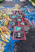 stock photo of hopscotch  - Hopscotch court drawn by chalk on urban pavement - JPG
