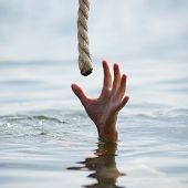stock photo of survival  - saving a drowning man  - JPG