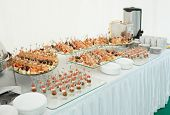 Various meat, fish and cheese banquet snacks on banquet table, catering event