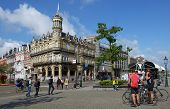 MAASTRICHT, NETHERLANDS - SEPTEMBER 8, 2013: Tourists in front of Grand Hotel near the train station