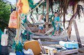 Little kids exploring rustic beach hut