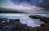 Beautiful Seascape Landscape Of Rocky Shore At Sunset