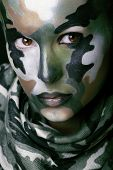 Beautiful young fashion woman with military style clothing and face paint make-up