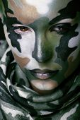 foto of khakis  - Beautiful young fashion woman with military style clothing and face paint make - JPG