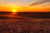 stock photo of kansas  - A view of the sunset in the Flint Hills of Kansas just outside of Alma Kansas