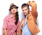 portrait of a fashion young couple looking at the camera in studio