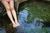 stock photo of legs air  - Women legs enjoys with hot springs water in Thailand - JPG