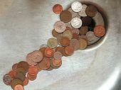 Money Poured Away Down Drain
