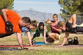 stock photo of rep  - Female fitness instructor counting for exercise class - JPG