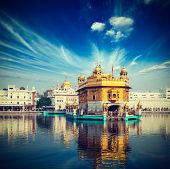 Vintage retro hipster style travel image of famous India attraction Sikh gurdwara Golden Temple (Har