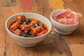 Chorizo Al Cava With Black Olives