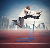 picture of overcoming obstacles  - Concept of career difficulty with jumping businessman - JPG