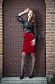 stock photo of woman red blouse  - Charming young brunette woman in black lace blouse - JPG