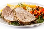 Roast pork, boiled potatoes and vegetable salad