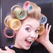 stock photo of hair curlers  - Portrait of funny happy woman in beauty salon - JPG