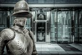 Spam.Medieval armor protecting a business building. Concept of firewall protection