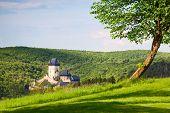 Karlstejn Castle In The Summer Forest