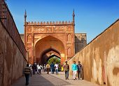 AGRA INDIA - JANUARY 28: A crowd of tourists visit Red Fort Agra on January 28 2014 in Agra Uttar Pr