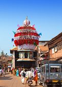 GOKARNA INDIA - JANUARY 31: The ancient wooden chariots with flags and paintings of hindu gods in th