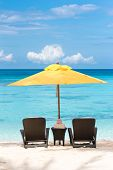 foto of boracay  - Sun umbrella and beach chairs on tropical beach Boracay - JPG