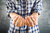 stock photo of beggar  - Male open hands for begging hopefully held up - JPG